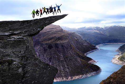 Daredevils perform stunts on Troll's Tongue in Norway – in