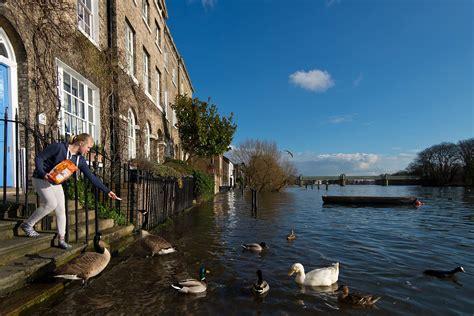 River Thames bursts its banks in west London as high tides